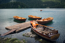 Group Of Wooden Boats On Black Lake In Montenegro