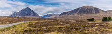 A Panorama View Of Munros On The Approach To Glencoe, Scotland On A Summers Day