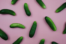 Cucumbers On A Pink Background Top View