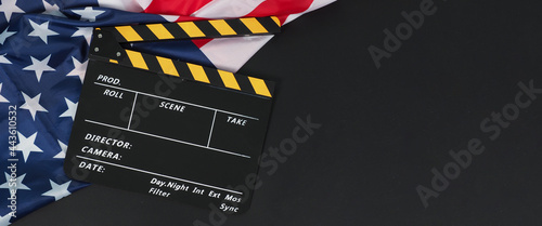 Canvas-taulu Black Clapper board or movie slate and Flag of the United States of America (USA