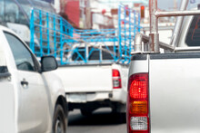 Rear Side Of Pick Up Cars On The Road In The City. Traffic Congestion With The Activities Of Many Transport Vehicles.