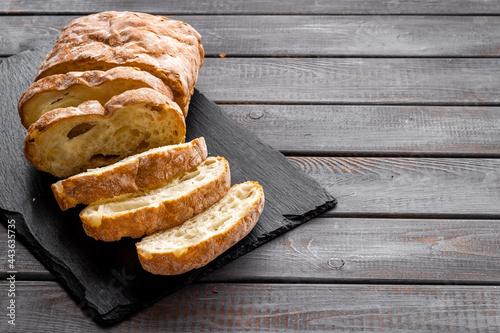 Fototapeta Fresh bread ciabatta loaf close up. Bakery background