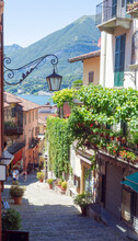 A Place Of Other Times, An Ancient Village With Cobbled Pedestrian Streets Overlooked By Traditional Colorful Houses With Flowered Balconies.Bellagio.Como Lake, Lombardy, Italy.