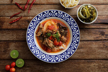 Local Northern Thai Food Rice Noodles With Pork In Spicy Soup In Wood Background