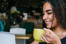 Young Woman Enjoying Coffee On Terrace