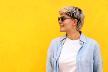 Stylish Young Girl With Short Hair, Sunglasses And Hair Wicks