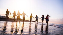 Group Of Young People Running At Sunset Beach - Happy Friends Having Fun Enjoying Summer Freedom Holiday On Sea - Friendship, Travel, Vacations And Summertime Concept