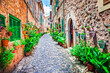 canvas print picture - Charming old streets decorated by flowers. Mediterranean culture and traditional villages