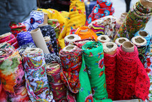 Dowry And Dress Fabrics In Accordance With Turkish Traditions. Bridal Fabrics. Colorful Fabrics Were Lined Up On The Shelves Of The Fabric Store. Selective Focus