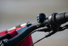 Close-up Of A Black Electric Bicycle Bell. Red Basket In The Background