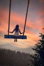 The Girl Swings On A Very High Swing, All The Way To The Sky.