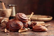 Cinnamon Buns On A Kitchen Table.