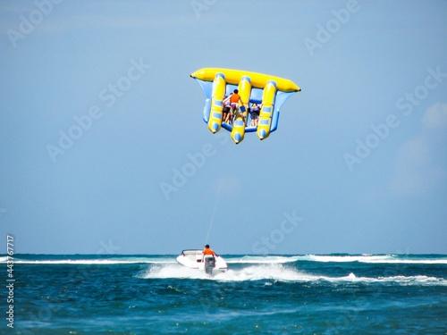 Fototapeta Flying fish water sport activity in Tanjung Benoa, Bali, Indonesia