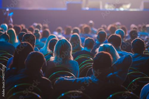 Fotografija Unrecognizable people sitting in dark auditorium