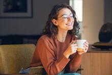 Beautiful Woman Relaxing And Drinking Hot Tea