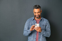 Mature Indian Man Messaging On Smartphone