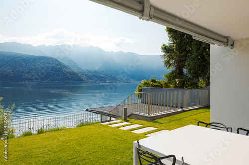 Canvas-taulu Private terrace overlooking Lake Ceresio in Switzerland