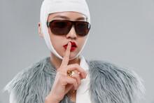 Beautiful Woman Wearing Sunglasses And Wearing A Bandage