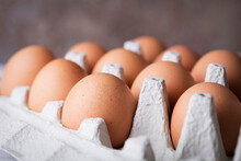 Close-up View Of Brown Chicken Eggs In Cardboard Tray