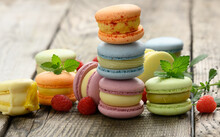 Stack Of Baked Multicolored Macarons And Different Flavors On A Gray Wooden Table, Delicious Dessert