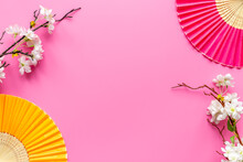 Japanese Hand Fan With Cherry Blossom Branch. Top View