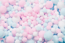 White, Pink And Blue Soft Pompons As A Background.