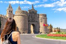 Woman With Her Back Facing The Puerta De La Bisagra (Gate Of Bisagra) In The Medieval City Of Toledo, Spain.