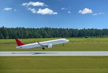 Passenger Plane Takes Off From Airport Runway In Forest