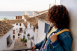 Horizontal view of unrecognizable woman traveling in Spain. Travel and holidays concept in summer.