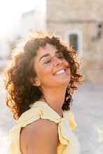 Vertical Portrait Of Cheerful Woman With White Teeth Smile. Happiness Concept On Travel And Holidays