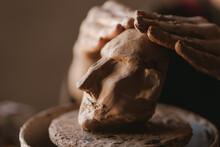 Young Woman Sculptor Artist Creating A Bust Sculpture