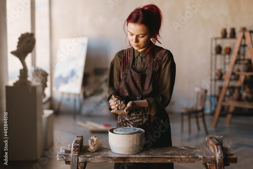 Young woman sculptor artist creating a bust sculpture Fototapet