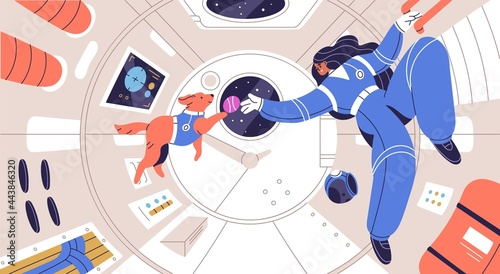 Obraz na plátně Weightless cosmonaut floating with dog in spaceship cabin