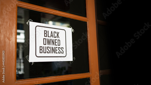 Fotografering Black owned business sign were attached on the window