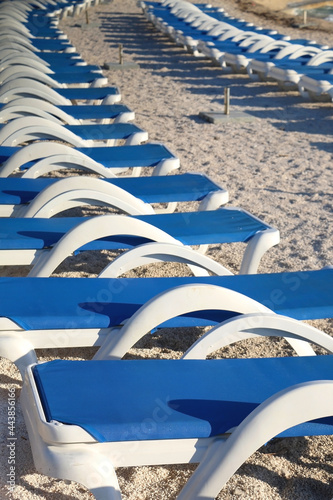 Fotografering Deck chairs arranged on a beautiful beach near Split, Croatia