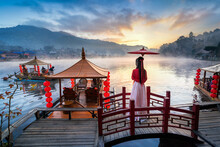 Asian Woman Wearing Chinese Traditional Dress At Ban Rak Thai Village In Mae Hong Son Province, Thailand.