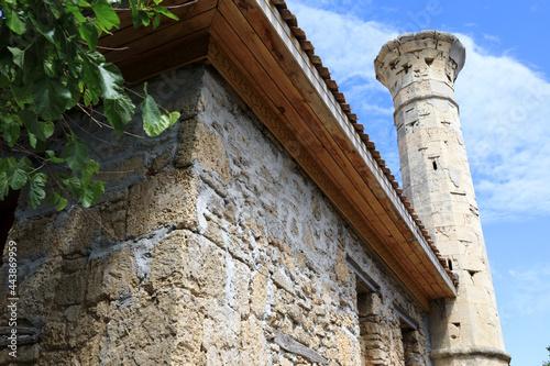 Fototapeta Old minaret of mosque Shukurala Efendi in Yevpatoria