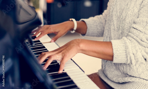 Fotografering Woman playing on a piano
