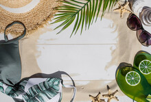 """The Concept Of A Holiday At The Sea. Shells, A Straw Hat, Sunglasses And The Word """"summer"""" On The White Sand. Background For Summer Holidays With Space For Text. Top View."""