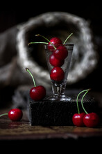 Photo Still Life Ripe Cherries In A Vintage Glass In A Low Key