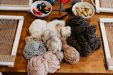 Weaving Looms With A Whole Bunch Of Wool
