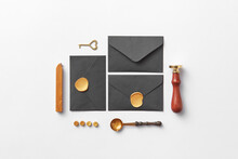 Flatlay Of Black Envelopes, Handle Stamp And Wax