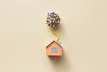 Beige Papercraft House Model With Balloons