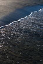 Calm Ocean Meeting The Sand