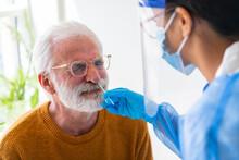 Elder Gentleman Doing COVID-19 PCR Test