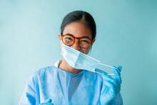Nurse Putting Face Mask On Smiling.