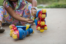 Young Girl Putting On Roller Skates