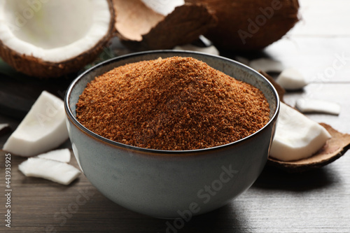 Fotografering Natural coconut sugar in ceramic bowl on wooden table