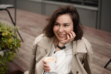 Happy Woman Spending Time With Coffee