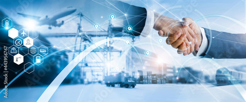 Fotografie, Obraz .businessman handshake of business deal with logistic  and transportation global